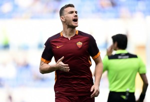 Roma's forward from Bosnia Edin Deko celebrates after scoring during the Italian Serie A football match Lazio vs AS Roma at the Olympic stadium in Rome on April 3, 2016 / AFP / FILIPPO MONTEFORTE (Photo credit should read FILIPPO MONTEFORTE/AFP/Getty Images)