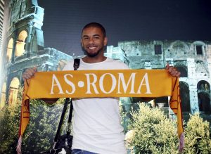 ROME, ITALY - AUGUST 16: AS Roma new signing Bruno Peres poses with AS Roma scarf at Fiumicino Airport on August 16, 2016 in Rome, Italy. (Photo by Luciano Rossi/AS Roma via Getty Images)